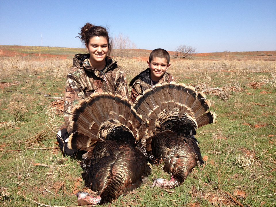 Photo - Mackenzie Jacobs, 16, and her brother Carson Jacobs, 11, bagged spring turkeys last Saturday on one of Sportsman's Country Club's hunting leases.   - PROVIDED BY DRU JACOBS