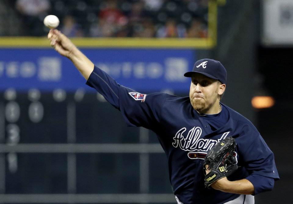 Photo - Atlanta Braves starting pitcher Aaron Harang throws against the Houston Astros during the second inning of a baseball game Tuesday, June 24, 2014, in Houston. (AP Photo/David J. Phillip)