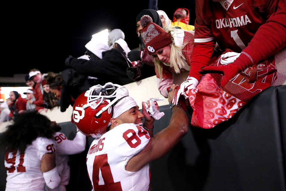 Photo - Oklahoma's Lee Morris (84) celebrates with fans following the Bedlam college football game between the Oklahoma State Cowboys (OSU) and Oklahoma Sooners (OU) at Boone Pickens Stadium in Stillwater, Okla., Saturday, Nov. 30, 2019. OU won  34-16. [Sarah Phipps/The Oklahoman]
