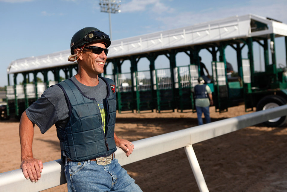Photo - Steve Gerwitz works with starting gate crew  at Remington Park Racetrack on Tuesday morning,  Aug. 16, 2011.  by Jim Beckel, The Oklahoman.  ORG XMIT: KOD
