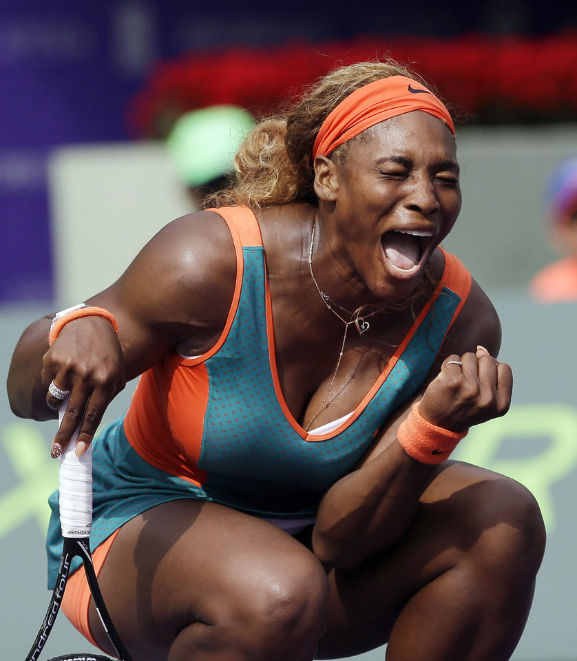 Photo - 10ThingstoSeeSports - Serena Williams celebrates after scoring a point against Caroline Garcia, of France, at the Sony Open tennis tournament in Key Biscayne, Fla., Saturday, March 22, 2014. Williams won 6-4, 4-6, 6-4. (AP Photo/Alan Diaz, File)