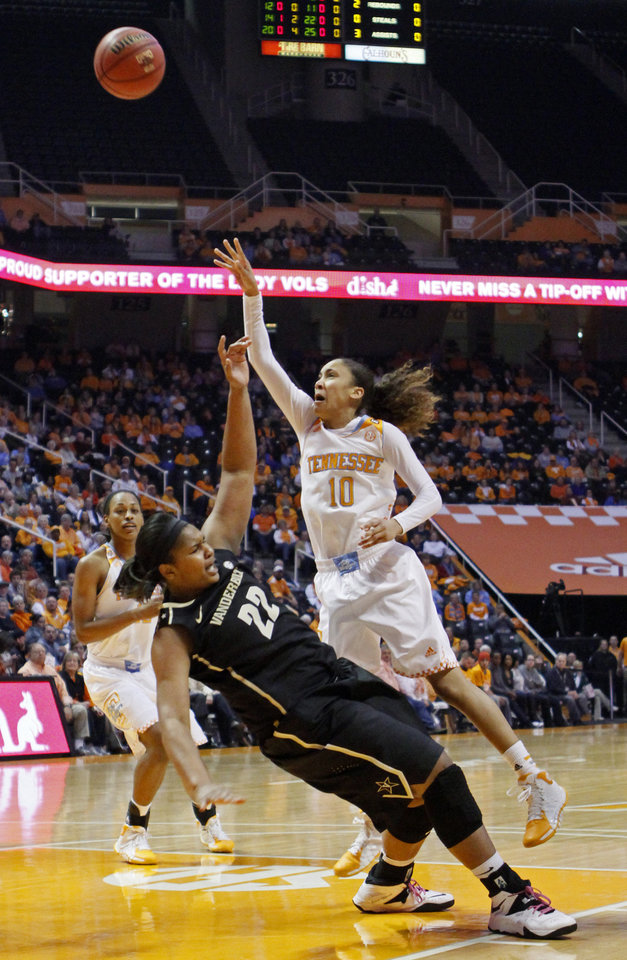 Photo - Tennessee guard Meighan Simmons (10) collides with Vanderbilt forward Marqu'es Webb (22) in the first half of an NCAA college basketball game, Monday, Feb. 10, 2014, in Knoxville, Tenn. (AP Photo/Wade Payne)
