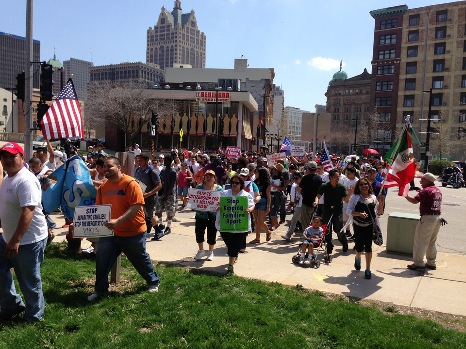 Hundreds of people marched through Milwaukee on Wednesday, May 1, 2013, to a park along the Milwaukee River to call for immigration reform and better protections for immigrant workers. The march and rally were organized by Voces de la Frontera. (AP Photo/M.L. Johnson)