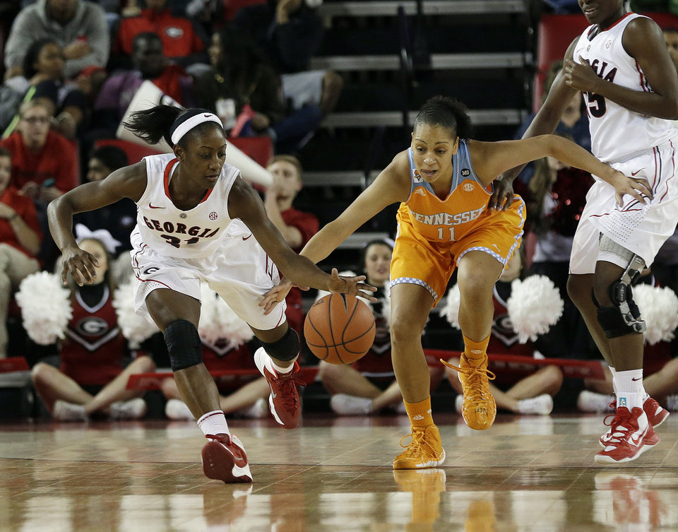 Photo - Georgia guard Erika Ford, left, and Tennessee forward Cierra Burdick (11) chase down a loose ball in the first half of an NCAA college basketball game Sunday, Jan. 5, 2014, in Athens, Ga. Tennessee won 85-70. (AP Photo/John Bazemore)