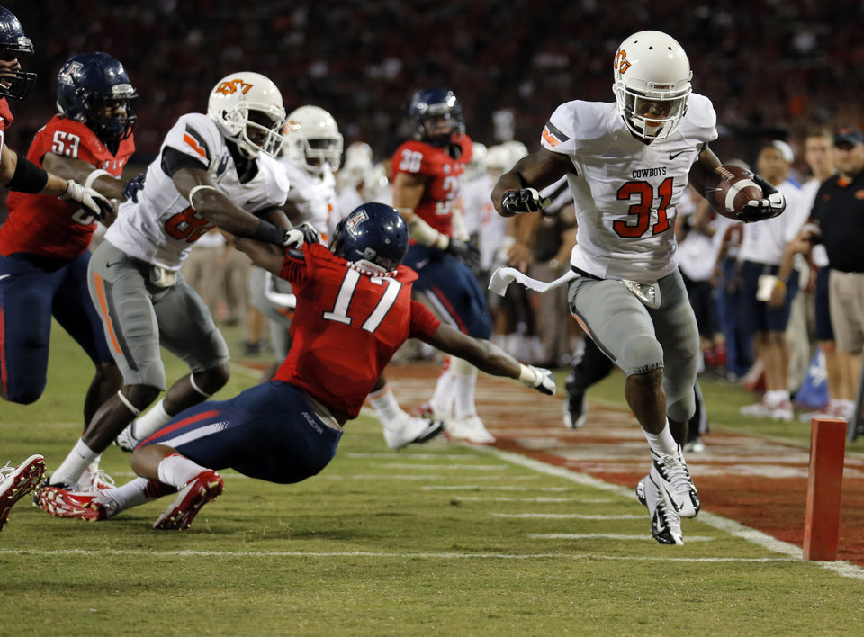 Photo - Oklahoma State's Jeremy Smith (31) scores a touchdown during the college football game between the University  of Arizona and Oklahoma State University at Arizona Stadium in Tucson, Ariz.,  Sunday, Sept. 9, 2012. Photo by Sarah Phipps, The Oklahoman