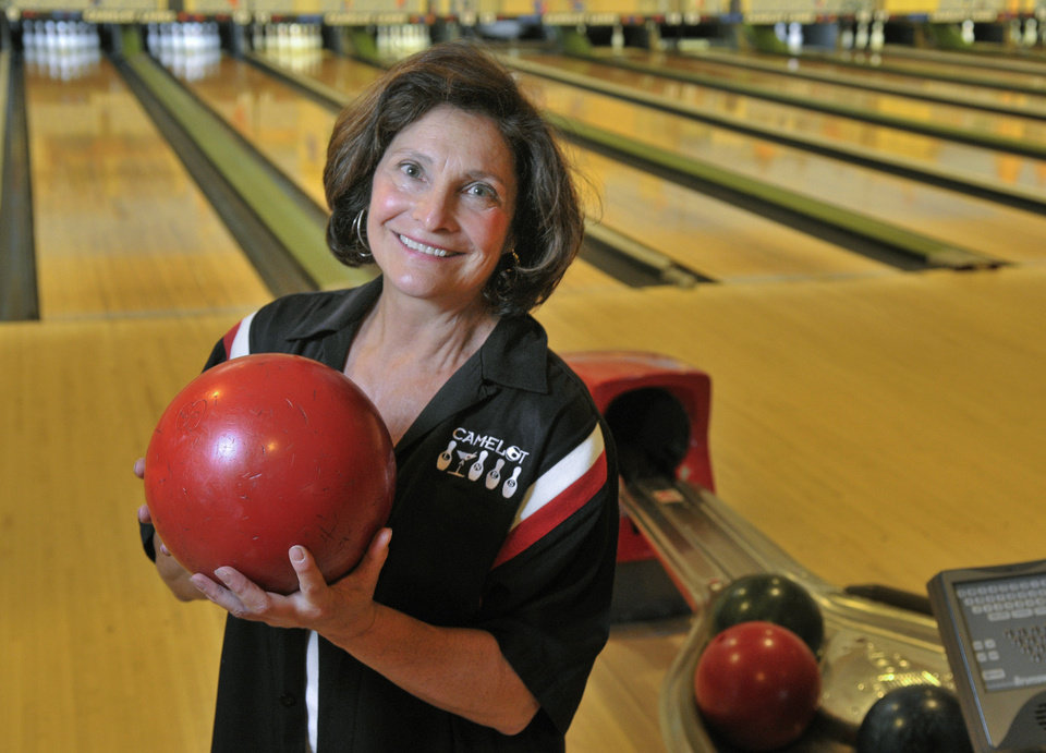 In this Thursday, Oct. 25, 2012 photo, owner Peppe Smith stands in her bowling alley in Boardman, Ohio. Smith sees positive signs all around her suburban Youngstown community.