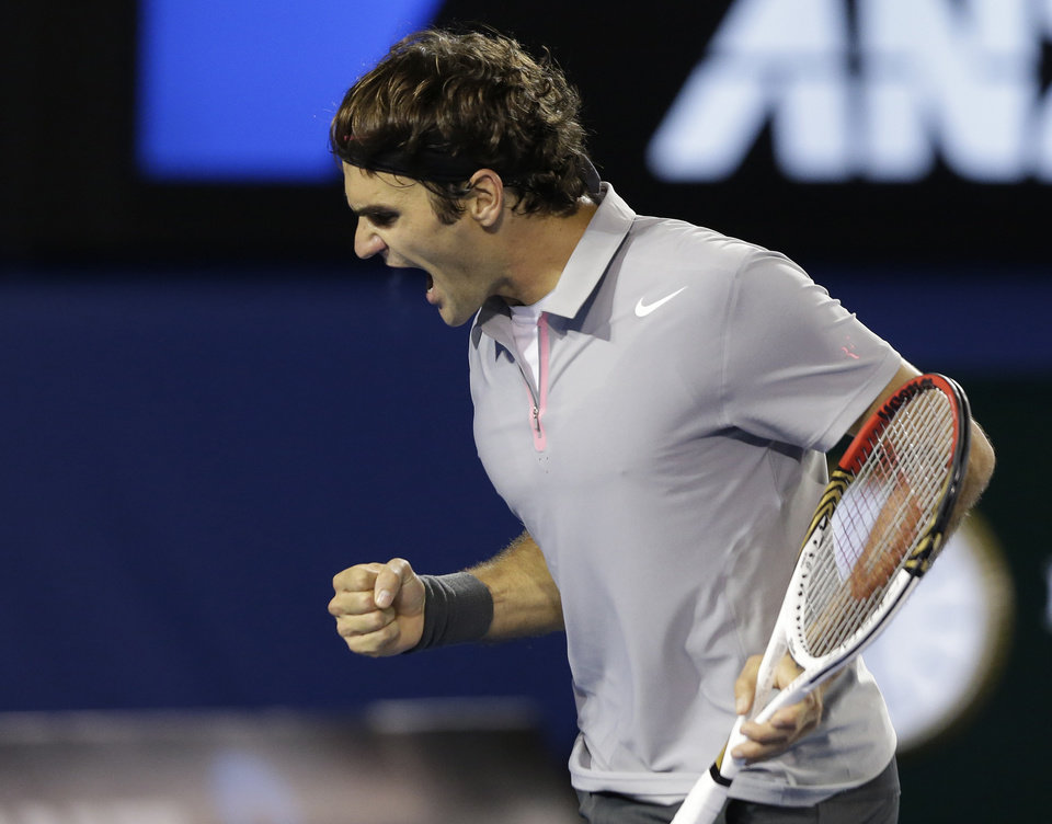 Photo - Switzerland's Roger Federer reacts after winning the second set of his men's semifinal against Britain's Andy Murray at the Australian Open tennis championship in Melbourne, Australia, Friday, Jan. 25, 2013. (AP Photo/Andy Wong)