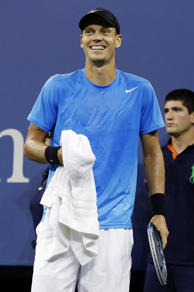 Photo -   Tomas Berdych, of Czech Republic, laughs after Roger Federer, of Switzerland, hit a passing shot during a quarterfinals match at the U.S. Open tennis tournament, Wednesday, Sept. 5, 2012, in New York. (AP Photo/Darron Cummings)