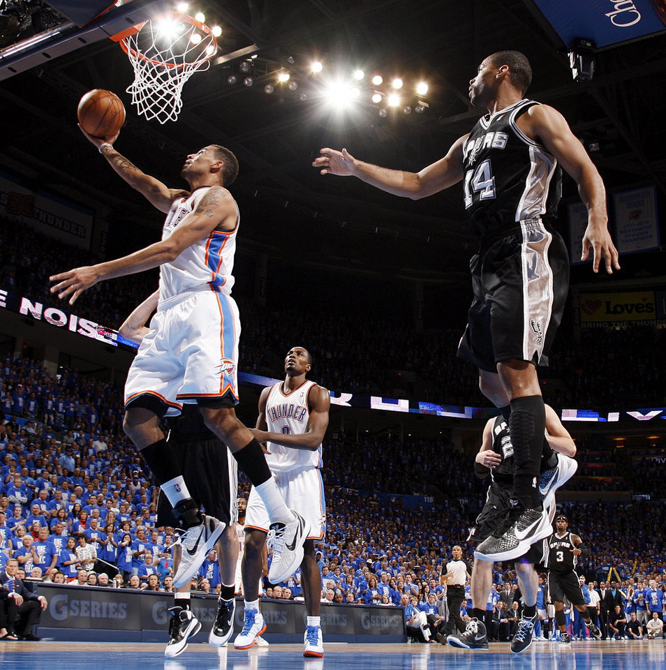 Oklahoma City's Thabo Sefolosha (2) takes a shot near San Antonio's Gary Neal (14) in front of Oklahoma City's Serge Ibaka (9) during Game 3 of the Western Conference Finals between the Oklahoma City Thunder and the San Antonio Spurs in the NBA playoffs at the Chesapeake Energy Arena in Oklahoma City, Thursday, May 31, 2012. Oklahoma City won, 102-82. Photo by Nate Billings, The Oklahoman
