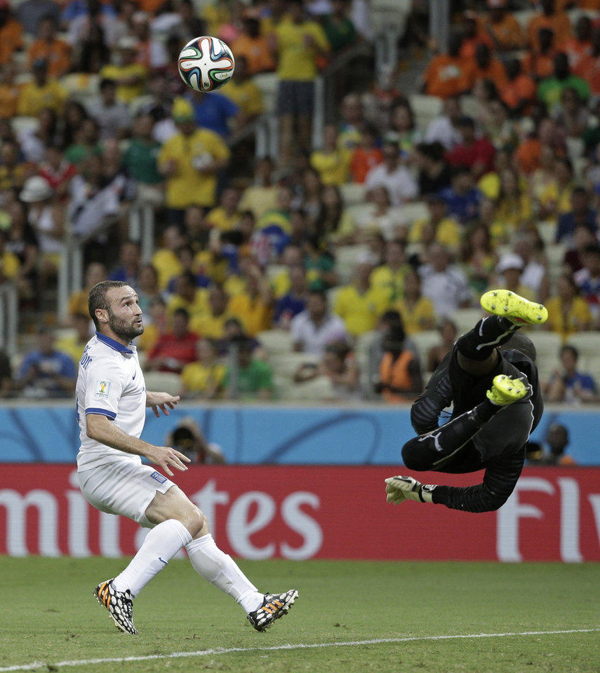 Photo - Ivory Coast's goalkeeper Boubacar Barry makes a save on a shot by Greece's Dimitris Salpingidis during the group C World Cup soccer match between Greece and Ivory Coast at the Arena Castelao in Fortaleza, Brazil, Tuesday, June 24, 2014. (AP Photo/Christophe Ena)