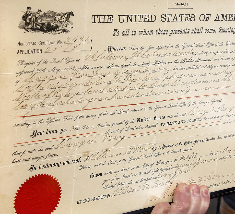 Photo -  The certificate of homestead issued to Maggie (Gossin) Gray, in May 1897 and signed by President William McKinley is  held by one of her grandsons, Wendell Gray. Photo by Jim Beckel, The Oklahoman   Jim Beckel -  THE OKLAHOMAN
