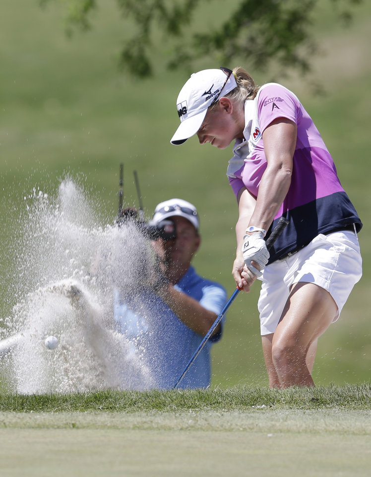 Stacy Lewis blasts out of the sand on the 11th hole during the final round of the North Texas LPGA Shootout golf tournament at Las Colinas Country Club in Irving, Texas, Sunday, May 4, 2014. (AP Photo/LM Otero)