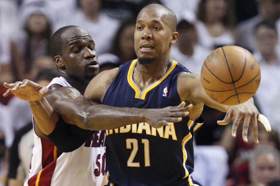 Photo -   Indiana Pacers forward David West (21) passes as he is guarded by Miami Heat center Joel Anthony during the second half of Game 1 in an NBA basketball Eastern Conference semifinal playoff series, Sunday, April 13, 2012, in Miami. The Heat won 95-86. (AP Photo/Wilfredo Lee)
