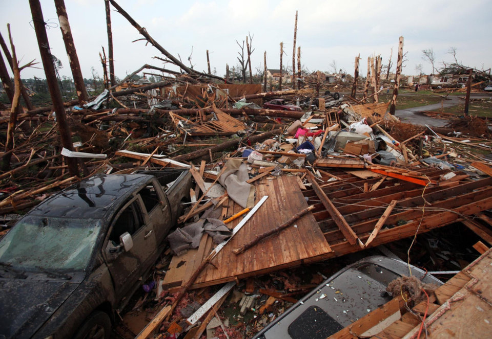 Photo - The Forest Lake neighborhood is completely destroyed in Tuscaloosa, Ala. Wednesday, April 27, 2011. A wave of severe storms laced with tornadoes strafed the South on Wednesday, killing at least 16 people around the region and splintering buildings across swaths of an Alabama university town. (AP Photo/The Tuscaloosa News, Dusty Compton)