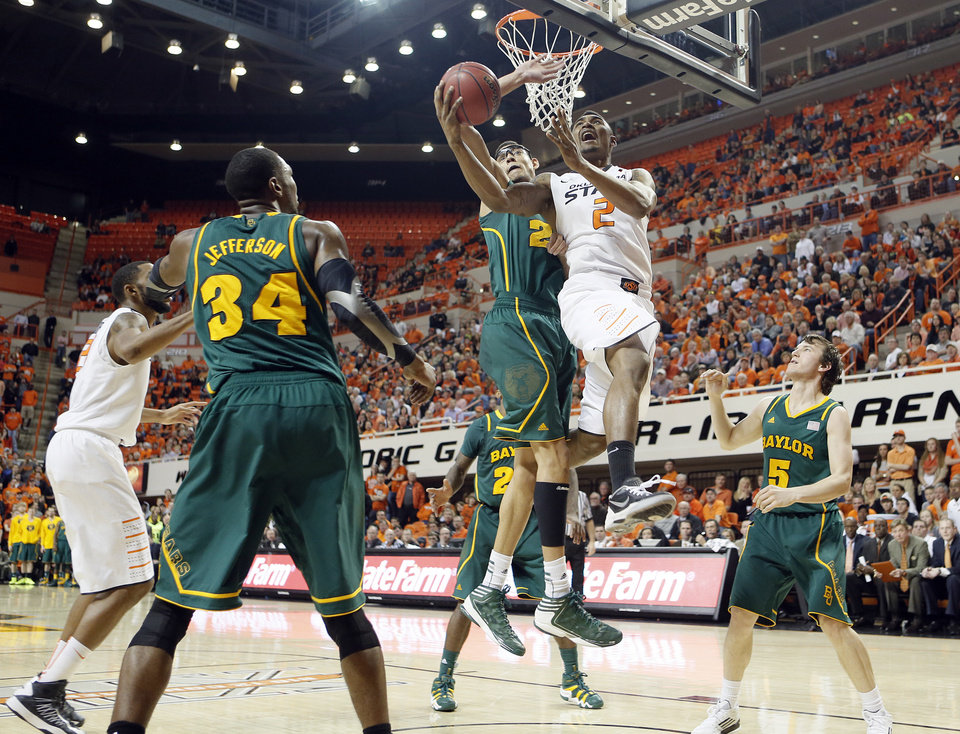Oklahoma State 's Le'Bryan Nash (2) drives to the basket past Baylor's Isaiah Austin (21) during the college basketball game between the Oklahoma State University Cowboys (OSU) and the Baylor University Bears (BU) at Gallagher-Iba Arena on Wednesday, Feb. 5, 2013, in Stillwater, Okla. Photo by Chris Landsberger, The Oklahoman