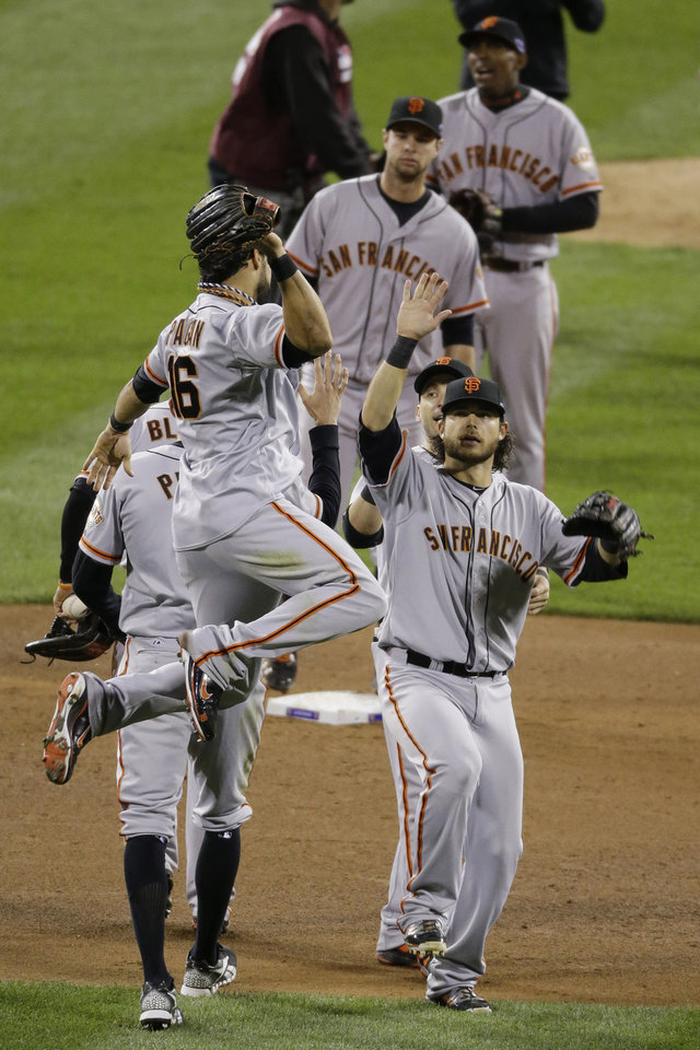 Photo -   San Francisco Giants' Angel Pagan (16) celebrates with teammates after Game 5 of baseball's National League championship series against the St. Louis Cardinals Friday, Oct. 19, 2012, in St. Louis. The Giants won 5-0 and trails in the series 3-2. (AP Photo/Mark Humphrey)