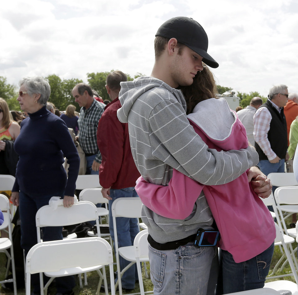 Patrick Weaver hugs a friend after an outdoor service for the First Baptist Church in a field Sunday, April 21, 2013, four days after an explosion at a fertilizer plant in West, Texas. Weaver's home was destroyed after a massive explosion at the West Fertilizer Co. Wednesday night that killed 14 people and injured more than 160. (AP Photo/Charlie Riedel)