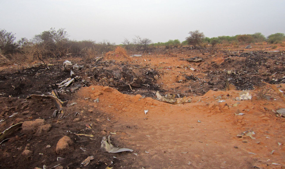 Photo - This photo provided on Friday, July 25, 2014,  by the Burkina Faso Military shows the site of the plane crash in Mali. French soldiers secured a black box from the Air Algerie wreckage site in a desolate region of restive northern Mali on Friday, the French president said. Terrorism hasn't been ruled out as a cause, although officials say the most likely reason for the catastrophe that killed all onboard is bad weather. At least 116 people were killed in Thursday's disaster, nearly half of whom were French. (AP Photo/Burkina Faso Military)