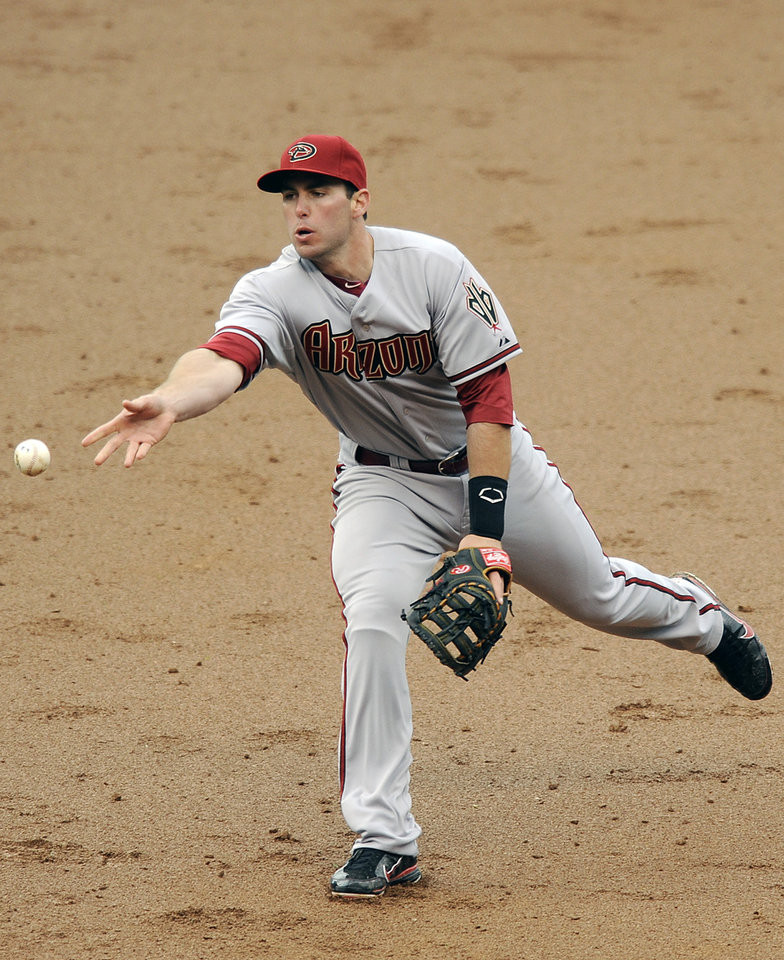 Arizona Diamondbacks second baseman Aaron Hill throws to first for the final out with the bases loaded in the eight inning of a baseball game against the Colorado Rockies on Sunday, April 15, 2012 in Denver. The Diamondbacks won 5-2. (AP Photo/Chris Schneider)