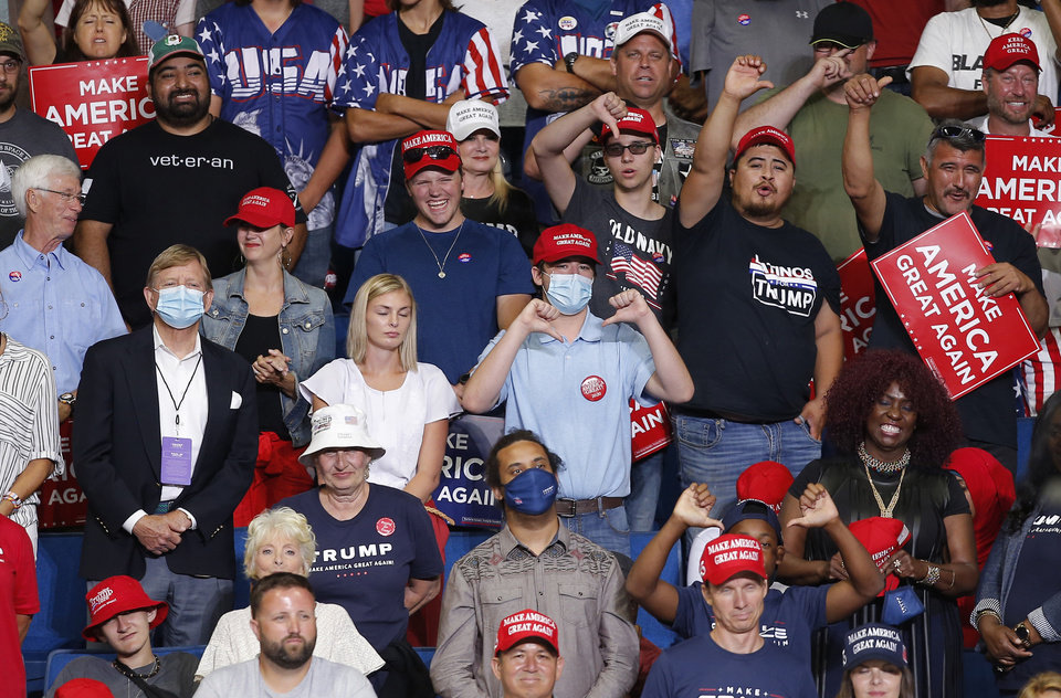 Photo - The crowd boos the press during a President Donald Trump rally at the BOK Center in Tulsa, Okla., Saturday, June 20, 2020. [Sarah Phipps/The Oklahoman]