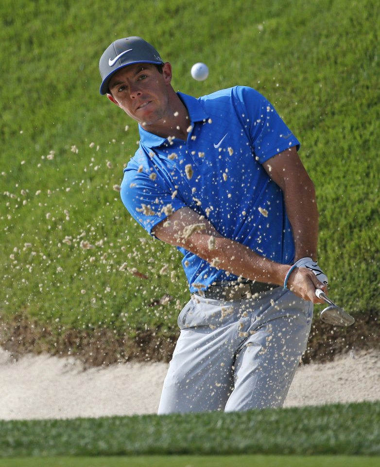 Photo - Rory McIlroy, of Northern Ireland, hits out of the bunker on the 14th hole during the third round of the PGA Championship golf tournament at Valhalla Golf Club on Saturday, Aug. 9, 2014, in Louisville, Ky. (AP Photo/Mike Groll)