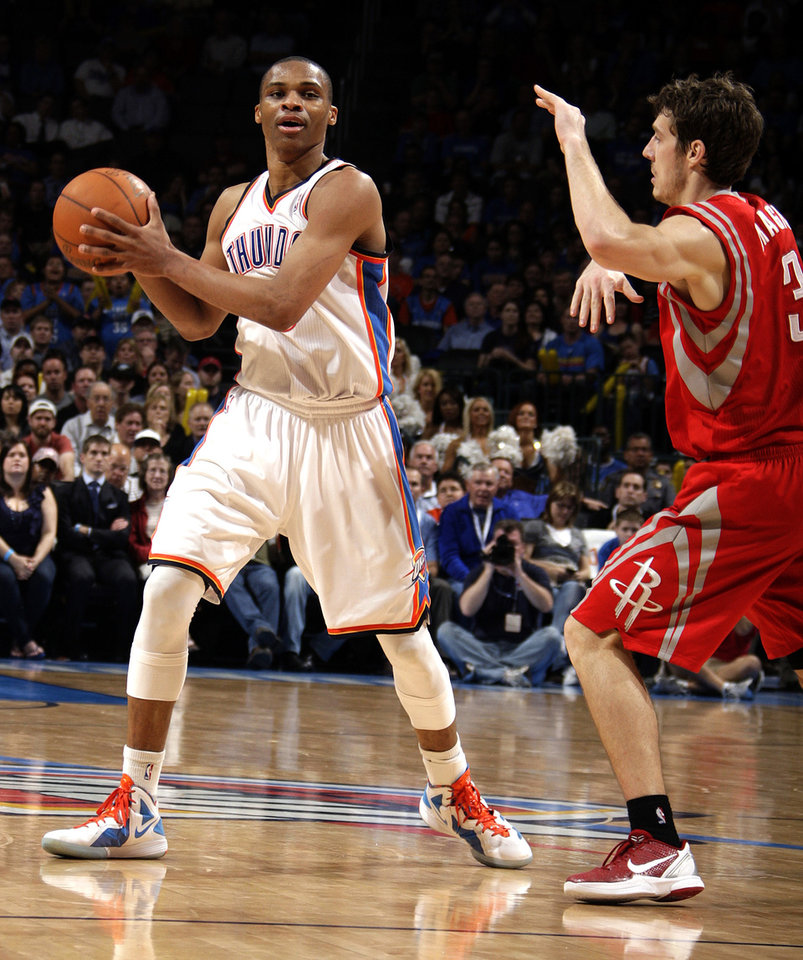 Photo - Oklahoma City's Russell Westbrook (0) tries to pass around Houston's Goran Dragic (3) during the NBA basketball game between the Oklahoma City Thunder and the Houston Rockets at the Chesapeake Energy Arena, Tuesday, March 13, 2012. Photo by Sarah Phipps, The Oklahoman.