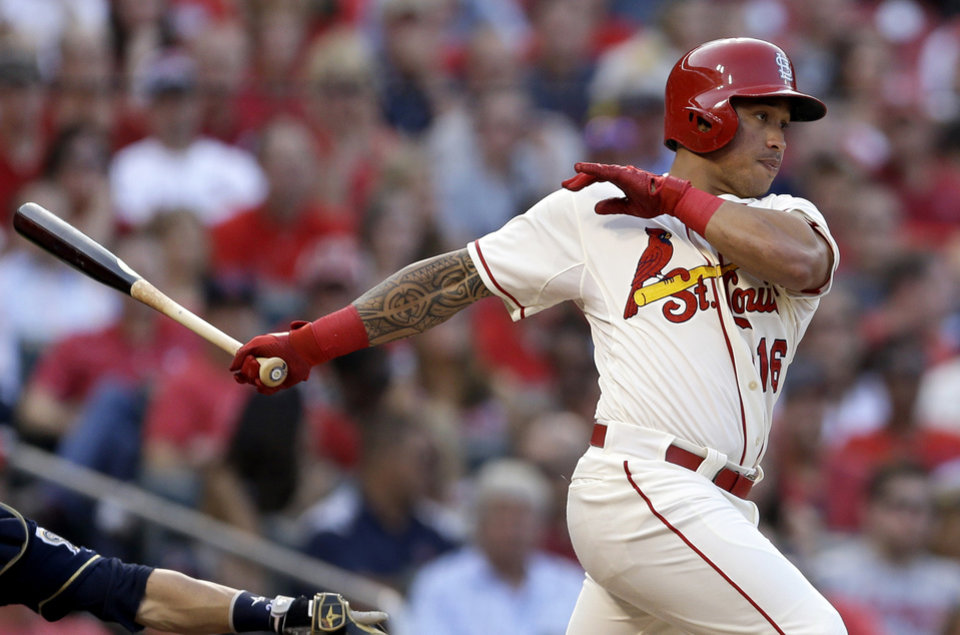 Photo - St. Louis Cardinals' Kolten Wong follows through on a two-run single during the second inning of a baseball game against the Milwaukee Brewers Saturday, Aug. 2, 2014, in St. Louis. (AP Photo/Jeff Roberson)