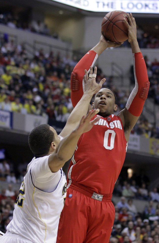 Photo -   Ohio State forward Jared Sullinger (0) goes up for a shot over Michigan forward Jordan Morgan in the first half of an NCAA college basketball game in the semifinals of the Big Ten Conference tournament in Indianapolis, Saturday, March 10, 2012. (AP Photo/Michael Conroy)