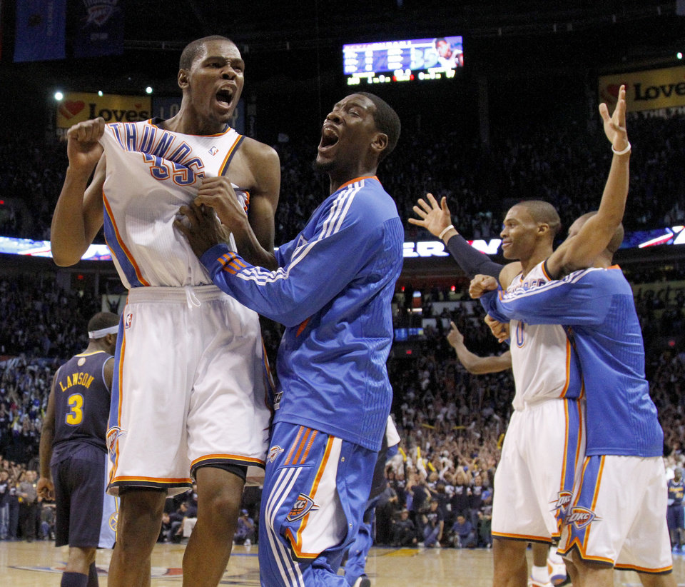 Oklahoma City's Kevin Durant (35) reacts with Oklahoma City's Royal Ivey (7) after the NBA basketball game between the Denver Nuggets and the Oklahoma City Thunder in the first round of the NBA playoffs at the Oklahoma City Arena, Wednesday, April 27, 2011. Photo by Bryan Terry, The Oklahoman