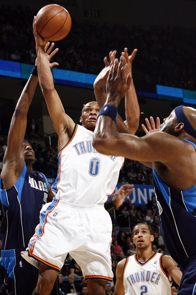Oklahoma City\'s Russell Westbrook (0) moves to the hoop between Josh Howard (5), left, and Erick Dampier (25) of Dallas as Oklahoma City\'s Thabo Sefolosha (2) looks on in the first half during the NBA basketball game between the Dallas Mavericks and the Oklahoma City Thunder at the Ford Center in Oklahoma City, March 2, 2009. BY NATE BILLINGS, THE OKLAHOMAN