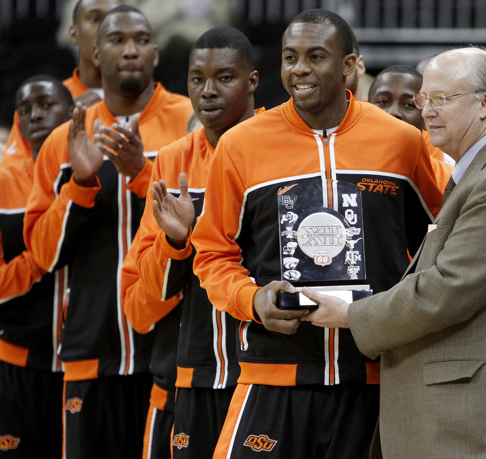 Photo - OSU's James Anderson is presented with the Big 12 Player of the Year award  before the college basketball game during the men's Big 12 Championship tournament at the Sprint Center on Wednesday, March 10, 2010, in Kansas City, Mo. Photo by Bryan Terry, The Oklahoman