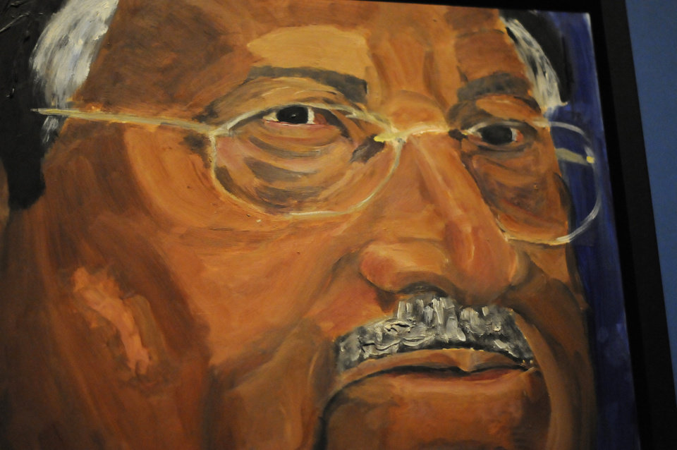 Photo - A detail of a portrait of former Pakistani President Pervez Musharraf which is part of the exhibit
