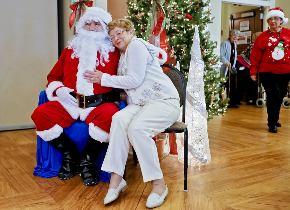 Betty Joyce snuggles up to Santa.