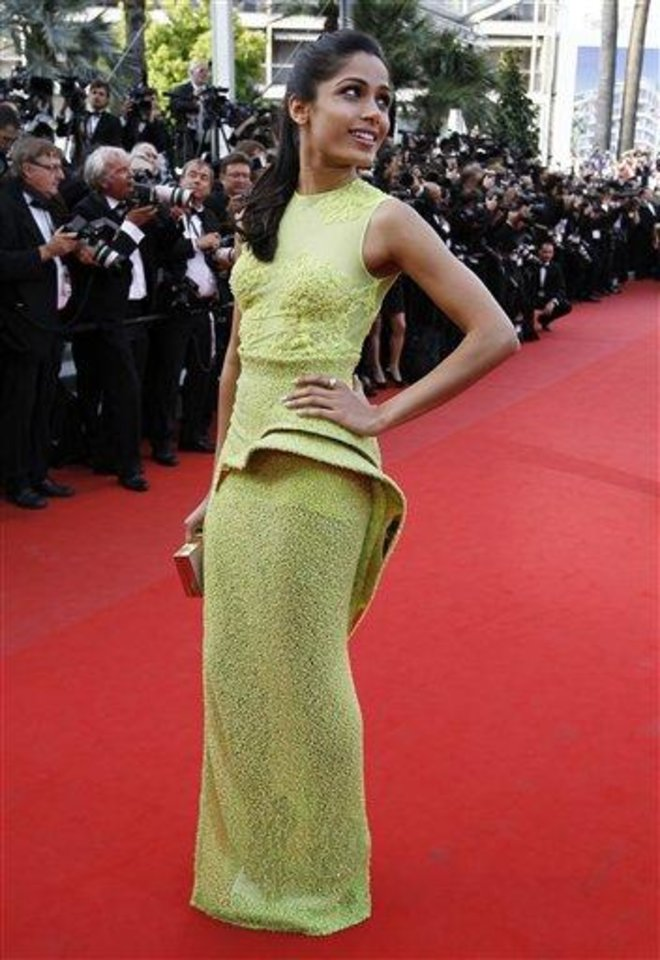 Photo - Actress Freida Pinto arrives for the screening of Rust and Bone at the 65th international film festival, in Cannes, southern France, Thursday, May 17, 2012.  Pinto is wearing Atelier Versace.(AP Photo/Francois Mori)