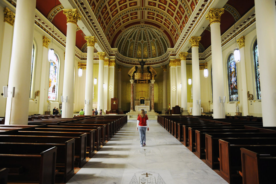 A tourist walks in the Cathedral Basilica of the Immaculate Conception in Mobile, Ala., on Saturday, March 1, 2014. Mobile is that �other� city on the northern Gulf Coast, the one that sometimes gets lost between the beaches of the Florida Panhandle and New Orleans. The church is among the free attractions in Mobile. (AP Photo/Jay Reeves)