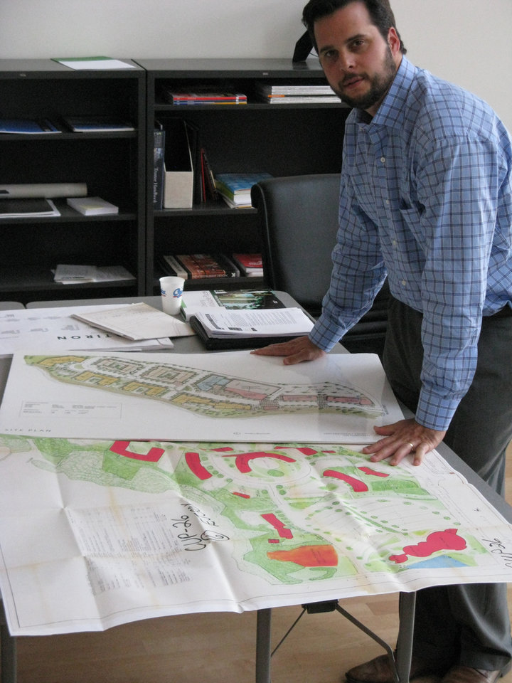 Photo - HOUSING - BUSINESS DEVELOPMENT PROPOSAL: Developer Grant Humphreys stands with site maps of his NW 36 Street mixed-use project. A close-up of the site plan is shown below. BY STEVE LACKMEYER, THE OKLAHOMAN ORG XMIT: 0807092210201419