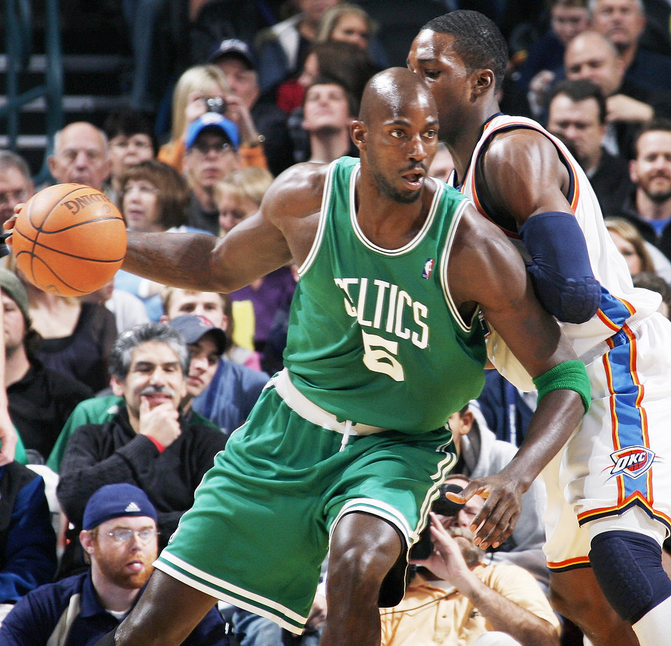 Photo - Boston's Kevin Garnett moves around Thunder forward Jeff Green during the Celtics' 105-87 win Friday at the Ford Center. The Celtics are looking more like the 2008 champions than last year's injury-ravaged team.  PHOTO BY NATE BILLINGS, THE OKLAHOMAN