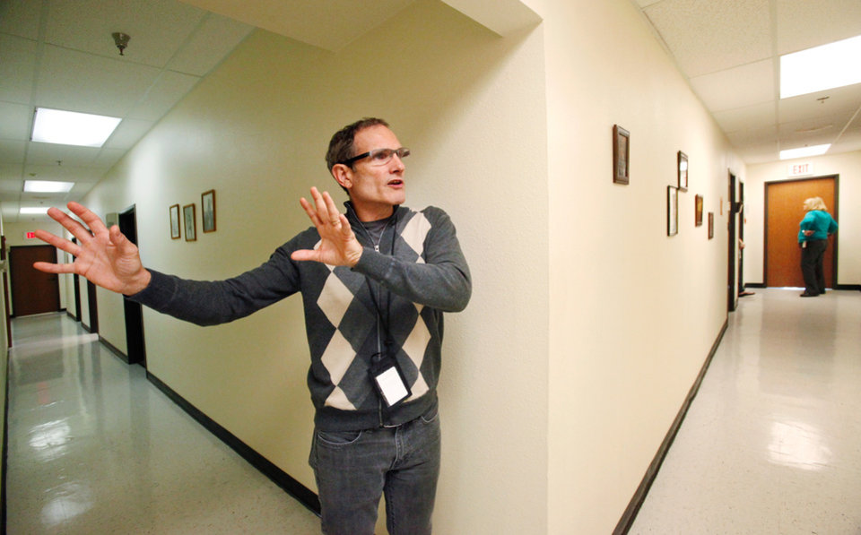 Photo - METHADONE CLINIC: Dan Cross, executive director of the  Absentee Shawnee Counseling Services,  discusses methadone treatments for patients who are addicted to heroin and other opiods. He is in one of the hallways of  the clinic where his staff provides treatments and counseling for patients  on SE 59 Street in Oklahoma City on Thursday, Nov. 10, 2011.   Photo by Jim Beckel, The Oklahoman  ORG XMIT: KOD