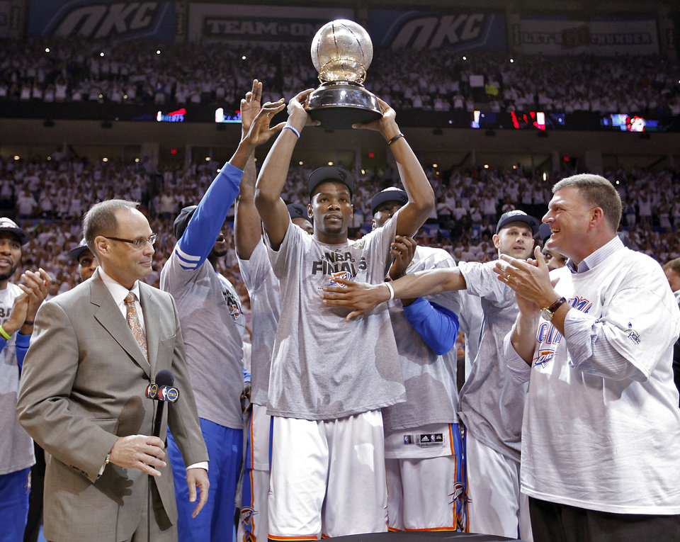 Photo - Oklahoma City's Kevin Durant holds the Western Conference Championship trophy after the 107-99 win over San Antonio during Game 6 of the Western Conference Finals between the Oklahoma City Thunder and the San Antonio Spurs in the NBA playoffs at the Chesapeake Energy Arena in Oklahoma City, Wednesday, June 6, 2012. Photo by Chris Landsberger, The Oklahoman
