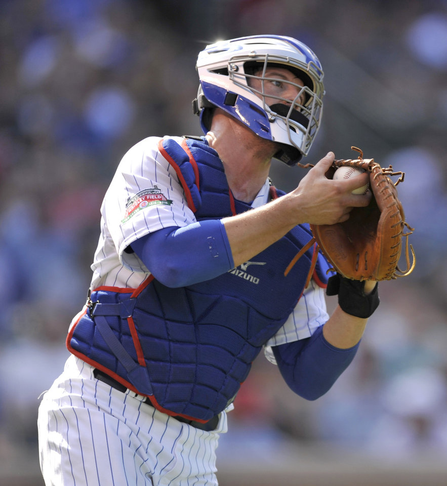 Photo - Chicago Cubs catcher John Baker catches a foul ball hit by Tampa Bay Rays' Brandon Guyer during the third inning of a baseball game in Chicago, Friday, Aug. 8, 2014. (AP Photo/Paul Beaty)