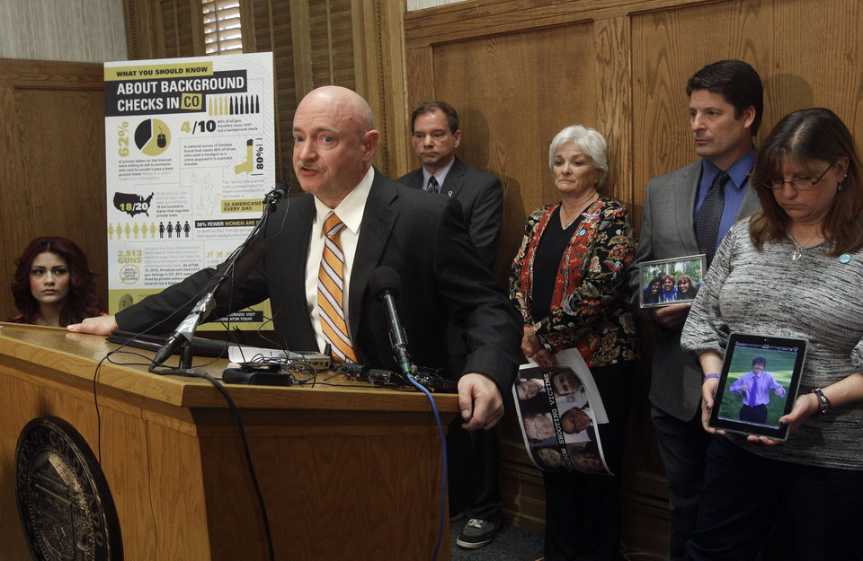 Retired Navy captain and astronaut Mark Kelly, the husband of former U.S. Rep. Gabrielle Giffords, speaks during a news conference in favor of proposed gun control legislation at the State Capitol, in Denver, Monday March 4, 2013. Behind him are, far left to right, Karina Sartiaguin, 18, who was shot in the back outside her high school in 2010, Tom Mauser, the father of Columbine High School shooting victim Daniel Mauser, Patricia Maisch, who helped take away a magazine from the Tucson shooter, Dave Hoover, the uncle of 18-year-old AJ Boik, one of 12 people killed in the Aurora theater shooting, and AJ Boik's mother Theresa Hoover. (AP Photo/Brennan Linsley)