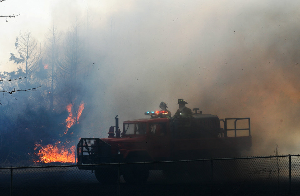 Photo - Wild fires burn out of control near NE 23rd and Dobbs Friday, March 11, 2011. Photo by Jim Beckel, The Oklahoman