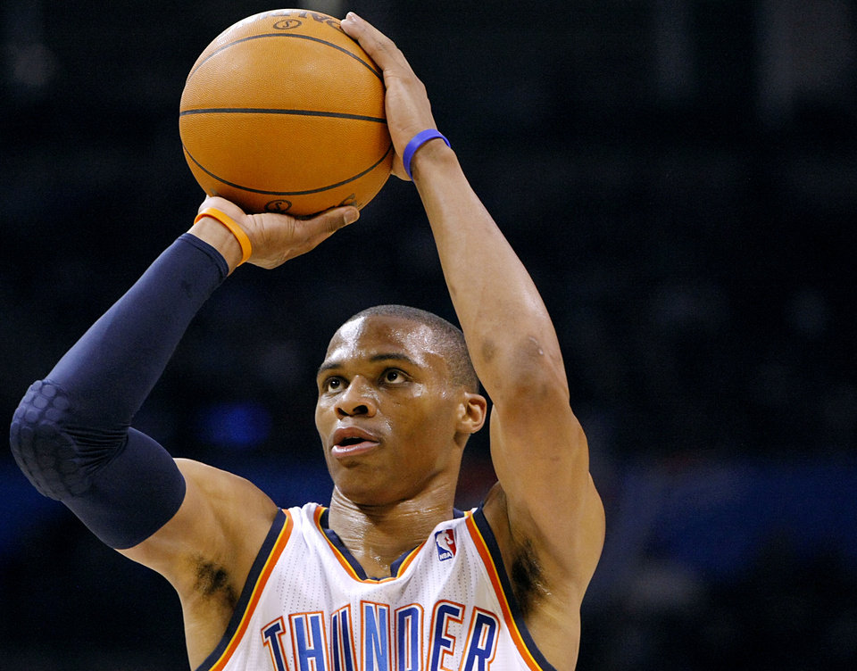 Photo - Oklahoma City's Russell Westbrook shoots a free throw against Houston during their NBA basketball game at the OKC Arena in downtown Oklahoma City on Wednesday, Nov. 17, 2010. Photo by John Clanton, The Oklahoman