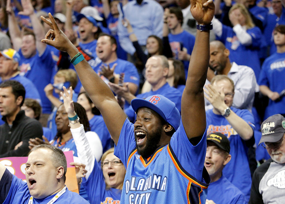 Photo - Thunder fan Ahmed Kabba, of Oklahoma City, celebrates with other fans during the second half of game 7 of the NBA basketball Western Conference semifinals between the Memphis Grizzlies and the Oklahoma City Thunder at the OKC Arena in Oklahoma City, Sunday, May 15, 2011. The Thunder beat the Grizzlies 105-90 to advance to the Western Conference finals against Dallas. Photo by John Clanton, The Oklahoman