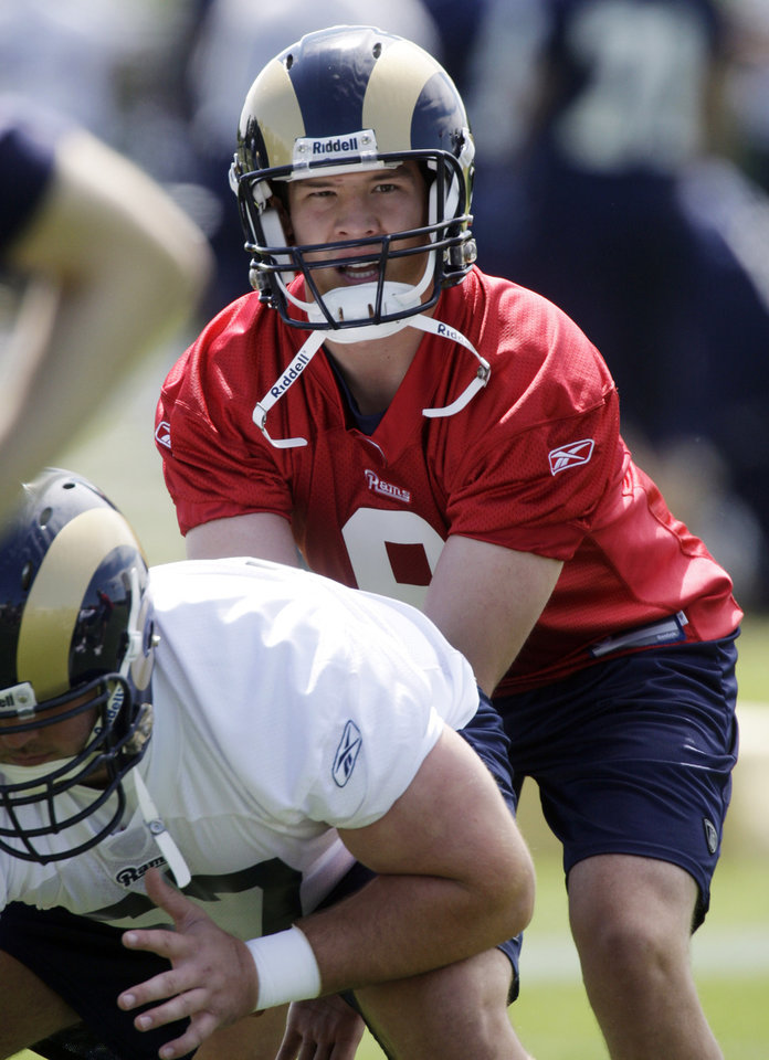 Photo - St. Louis Rams quarterback Sam Bradford prepares to take a snap during NFL football organized team activities at the Rams' training facility, Tuesday, May 18, 2010, in St. Louis. (AP Photo/Jeff Roberson) ORG XMIT: MOJR105