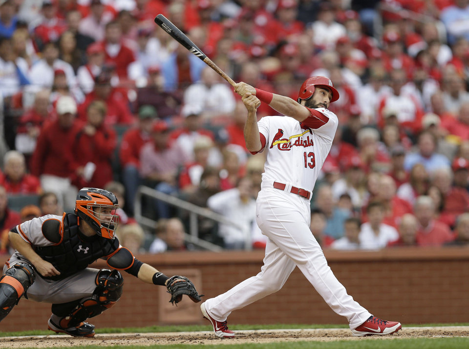 Photo -   St. Louis Cardinals' Matt Carpenter (13) watches the ball as he hits a two-run home run during the third inning of Game 3 of baseball's National League championship series against the San Francisco Giants, Wednesday, Oct. 17, 2012, in St. Louis. (AP Photo/David J. Phillip)