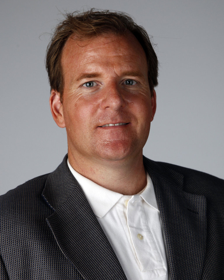 Photo - Todd Gralla, an architect with Populous in Norman, poses for a photo in the OPUBCO studio, Monday, July 23, 2012.  Photo by Garett Fisbeck, The Oklahoman