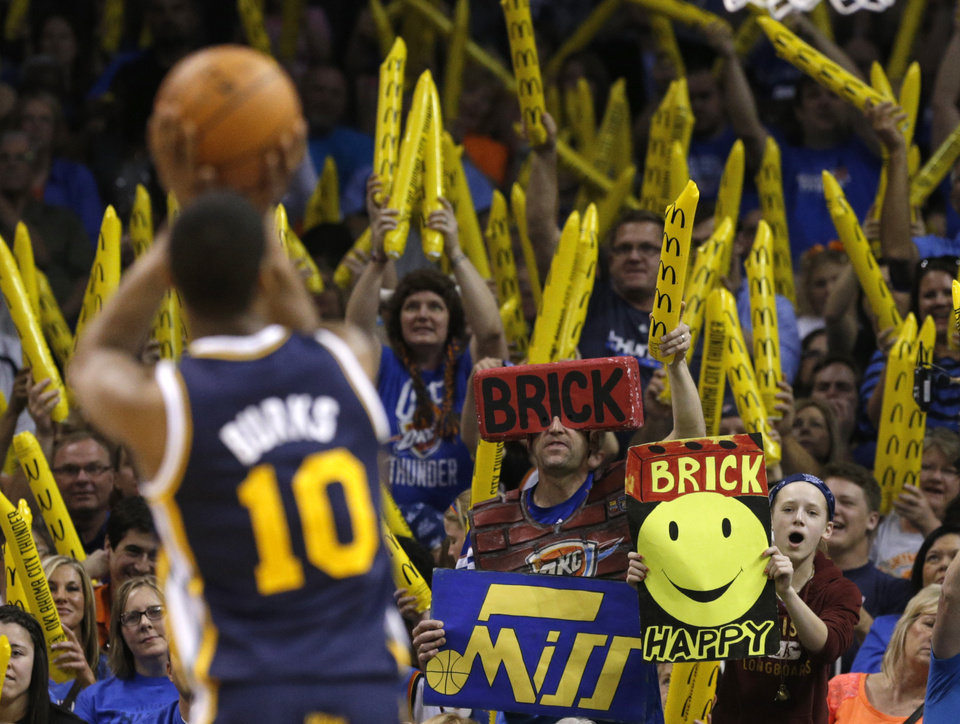 Photo - Fans try to distract Utah's Alec Burks (10) during the NBA game between the Oklahoma City Thunder and the Utah Jazz at the Chesapeake Energy Arena, Sunday, March 30, 2014, in Oklahoma City. Photo by Sarah Phipps, The Oklahoman