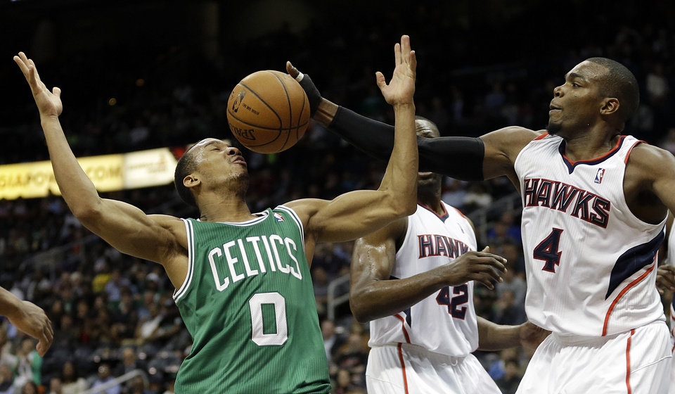 Photo - Atlanta Hawks' Paul Millsap, right, reaches for a loose ball against Boston Celtics' Avery Bradley in the fourth quarter of an NBA basketball game, Wednesday, April 9, 2014, in Atlanta. Atlanta won 105-97. (AP Photo/David Goldman)