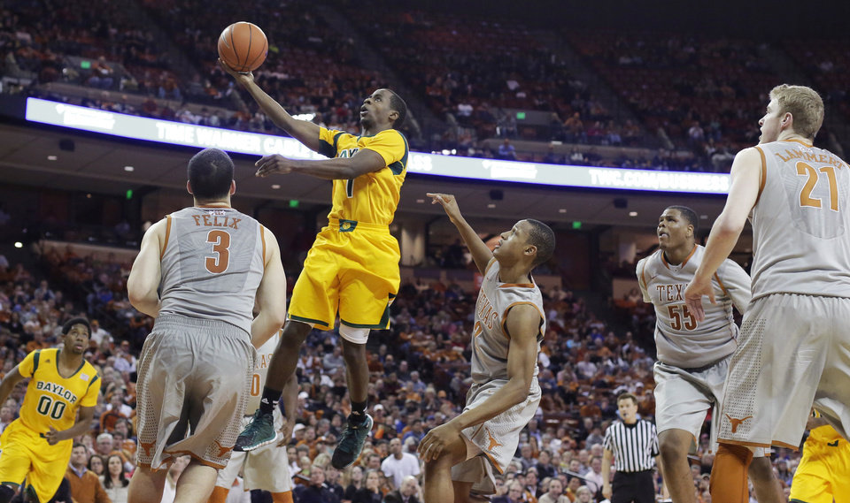 Photo - Baylor's Kenny Chery (1) shoots over Texas' Javan Felix (3) during the second half of an NCAA college basketball game, Wednesday, Feb. 26, 2014, in Austin, Texas. Texas won 74-69. (AP Photo/Eric Gay)